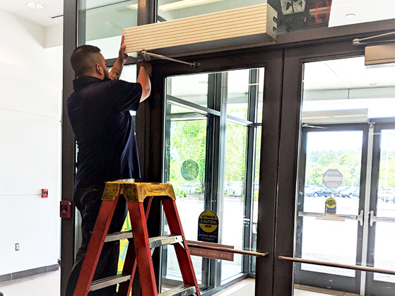 24-Hour service person fixing an automatic door from Texas Access Controls