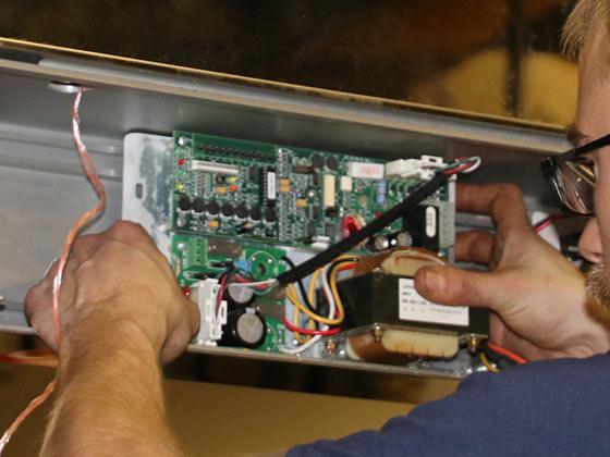 Door maintenance contracts service person fixing automatic door TAC